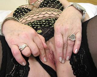Horny mature slut fingering herself